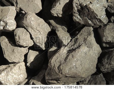 Stock of broken shiny anthracite coal pieces