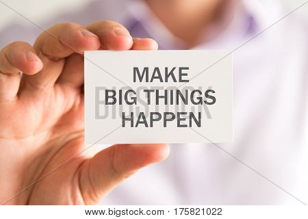 Businessman Holding A Card With Make Big Things Happen Message