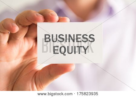 Businessman Holding A Card With Business Equity Message