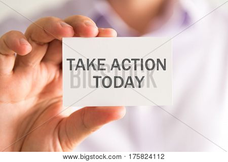 Businessman Holding A Card With Take Action Today Message