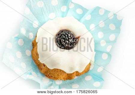 Vanilla cupcake with blackberries isolated on white background