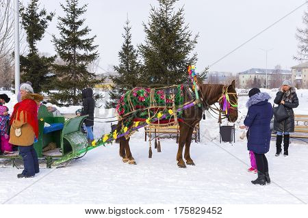 Berdsk Novosibirsk oblast Siberia Russia - February 26 2017: horseback riding in the sleigh. The Holiday Of Maslenitsa