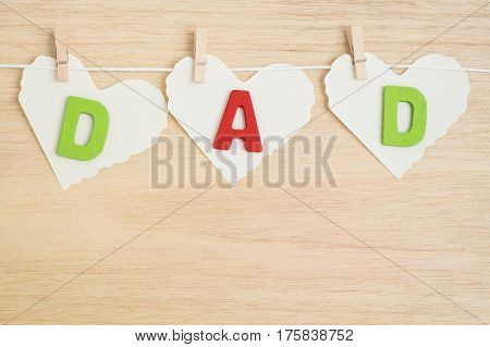 Dad alphabet on heart paper style hang on wooden background - Happy Father's day concept