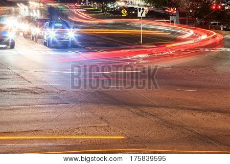 LAWRENCEVILLE, GA - NOVEMBER 2016: The headlights and brakelights from cars turning at a busy intersection motion blur and streak in Lawrenceville GA on November 23 2016.