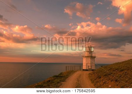 Evening Landscape With Lighthouse