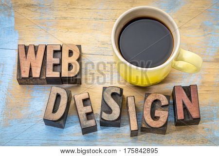 website design - word abstract in vintage letterpress wood type printing blocks against grunge wood witth a cup of coffee