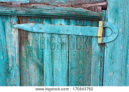 Part Old Wooden Shabby Blue Door On A Farm.