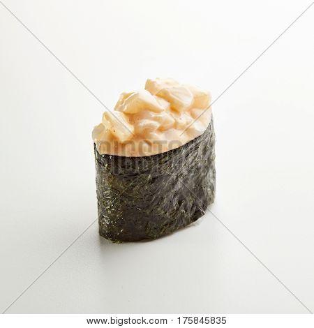 Japanese Sushi - Ika Gunkan Sushi (Nori wrapped Scallop Sushi) on White Background