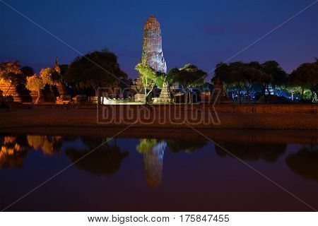 The ruins of ancient Buddhist temple Wat Phra Ram in the night landscape. Ayutthaya, Thailand