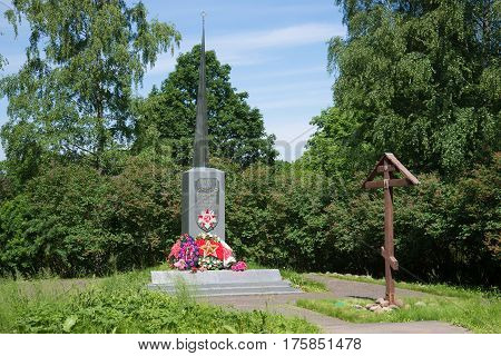 KOROSTYN, RUSSIA - JUNE 02, 2016: the Monument to soldiers who died during the great Patriotic war and a memorial Orthodox cross on a sunny June day