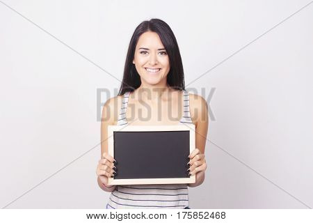 Young Woman Holding A Chalkboard