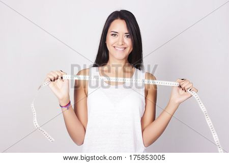 Young Caucasian Woman Holding A Measure Tape