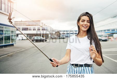 Cute Woman In White Shirt Holding Selfie Stick