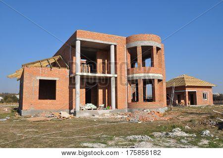 Brick House construction. Home Building Process and Construction Site. Building a house stages.