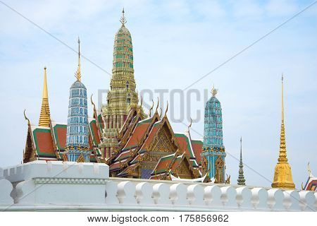 Prangs of the Great Royal Palace in the center of Bangkok on a cloudy morning. Thailand