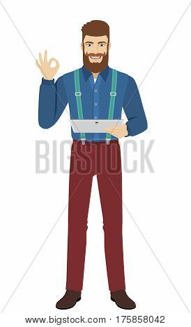 Hipster holding digital tablet PC and show a okay hand sign. Full length portrait of hipster in a flat style. Vector illustration.