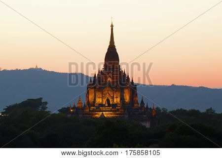 The peak of the ancient Buddhist temple of Gawdaw Palin at sunset. Bagan, Myanmar