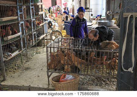 Yuanyang, China - February 21, 2017: Hani People Buying Stuff In The Shengcun Local Market In Yuanya