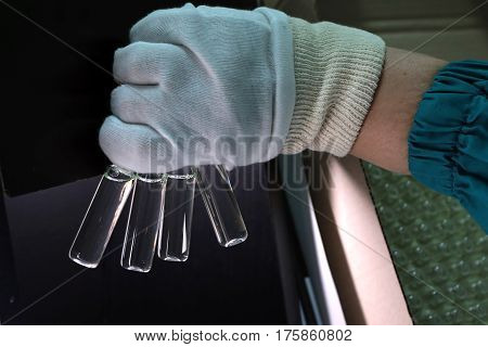 People Hand Holding A Test Tube Vial Sets For Analysis In The Gas Liquid Chromatograph. Laboratory A
