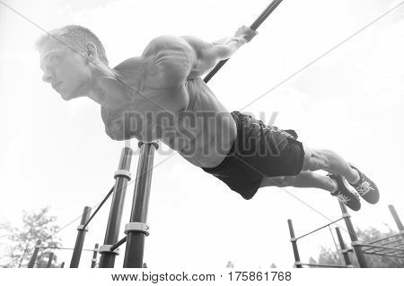 Man Doing Exercises In Outdoor Gym Naked Torso.