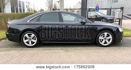 Naarden, The Netherlands - March 11, 20178 Black Audi A8 parked by the side of the road. Nobody in the vehicle.