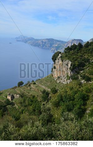 Italy's Amalfi Coast with rolling hills and the winding coastline.