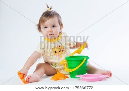 Cute baby with bucket and spade isolated on white background. poster