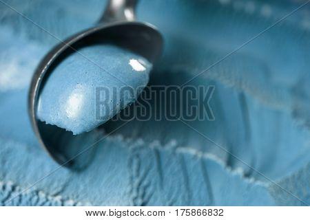 scooping blue ice cream close up shot shallow focus