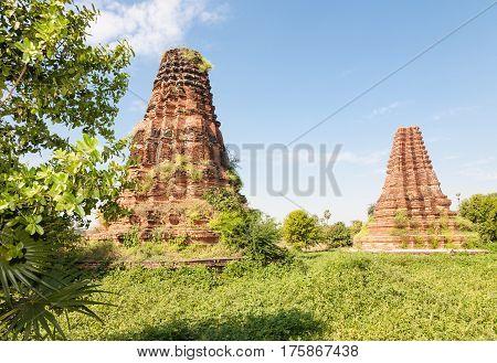 Two old historic brick towers near the Bagaya monastery at the ancient capital called Inwa or Ava near Mandalay in Burma
