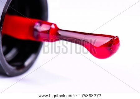 red nail polish bottle and nail brush on white background