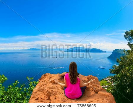 Young woman meditating outdoors at The beautiful Capri island. Collage