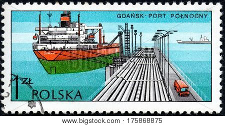 UKRAINE - CIRCA 2017: A stamp printed in POLAND shows Port in Harbour Gdansk series Polish Harbours circa 1976