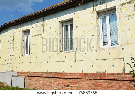 Close up on Thermal House Insulation Exterior. Facade Wall Insulation with Styrofoam Polystyrene with Stucco for House Energy Saving Outdoor.