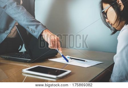 Businessman or boss complain to Businesswoman or employee at office.
