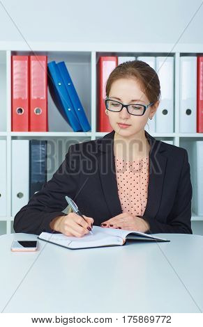 Business woman making notes at office workplace. Business job offer financial success certified public accountant concept.