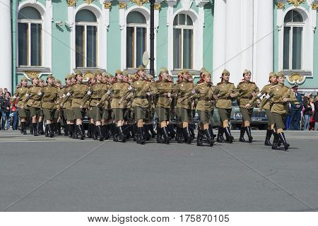 SAINT PETERSBURG, RUSSIA - MAY 05, 2015: Girl soldiers in the form of world war II on the rehearsal of parade in honor of Victory Day