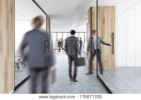 Rear view of businesmen in suits walking in an office corridor with wood and glass decoration elements. 3d rendering