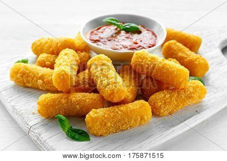 Breaded mozzarella cheese sticks with tomato basil sauce.