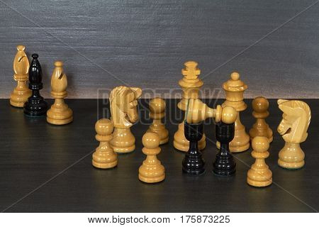 Creation of nativity scenes with chess figures against a dark background.