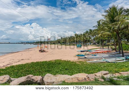 The Strand beach with lifeguard safe swimming nets kayaks and palm trees Townsville Australia