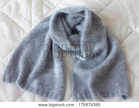 Soft Blue Angora Scarf Tied By Hand On Natural Wooden Background With Cotton Branch