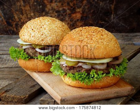 Veggie Burgers With A Chop Of Black Beans, Lettuce, Pickled Onions, Cucumber On A Wooden Background.