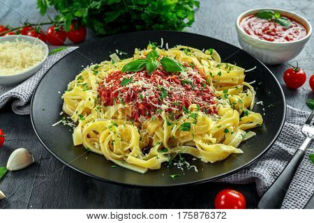 Homemade Hot Pasta with Marinara Sauce, Basil, Garlic, Tomatoes, parmesan cheese on plate