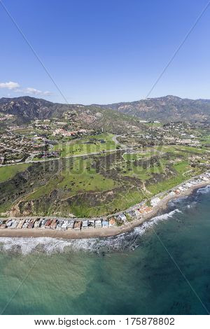 Aerial view of Malibu beach homes and hillsides in Southern California.