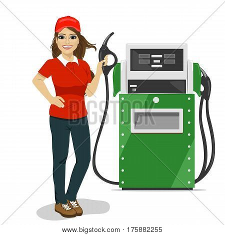 Female gas station worker holding a petrol pump standing next to fuel dispenser