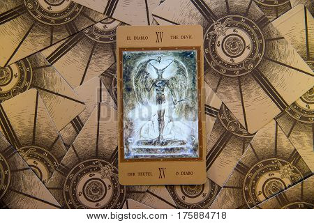 Moscow Russia - January 29 2017: Tarot card The Devil. Labirinth tarot deck. Esoteric occult background