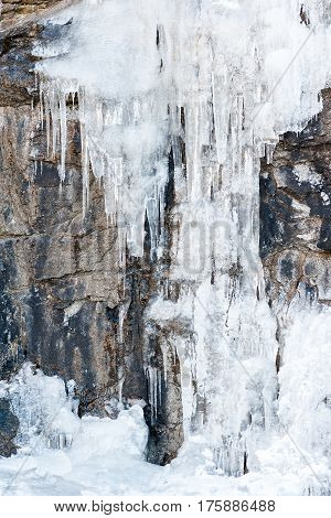 icicles from ice on frozen on the mountain wall