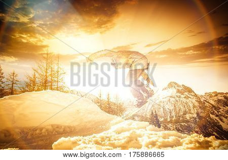 Snowboarder performing tricks on the snow with dramatic background