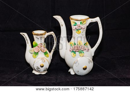 a pair of very old porcelain vases