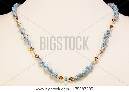 a custom made necklace made with faceted beads